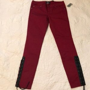 Burgundy skinny pants with lace up detail